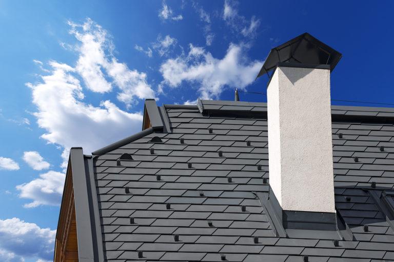 dark gray metal roofing with white chimney on Lansing, MI, home